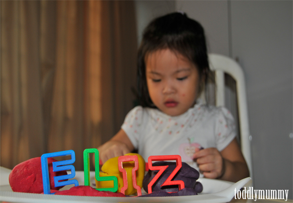 Elizabeth playing playdough