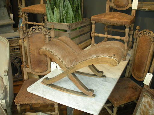 I love the rustic simplicity of wood, leather and fur. This is such a unique piece!