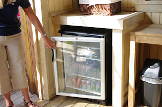 A stocked refrigerator inside the cabana.  Waters and sodas are available cold.
