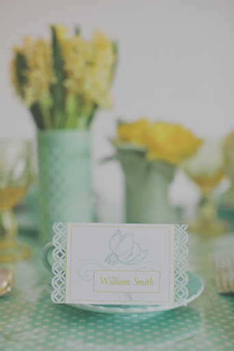 A place card with a decorative edge compliments the vases and textures of the flowers.
