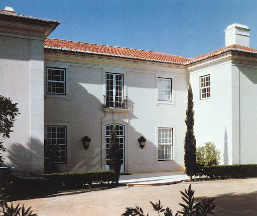 The allure of Portugal and the calm and sturdy facade of a house for Mrs. Graham D. Mattison by Valerian Rybar.