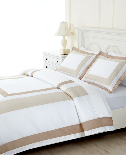The neutral stripes on this bed are unobtrusive and elegant.  (macys.com)