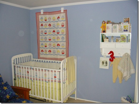 crib, quilt and shelf