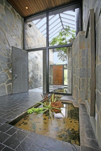 This homeowner has installed a zen pond to greet their guests with. (Elle Decor)