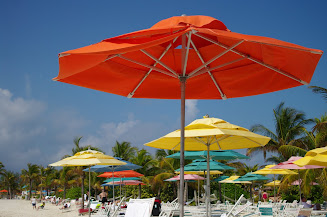 It's pretty to look up and down the beach and see the different colored umbrellas.