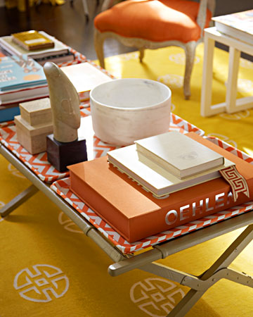 Decorating Editor Rebecca Robertson created a beautiful living space in the design studio at Martha Stewart Living. Her coffee table, pictured here, made from an old cot and several trays, is very camp-chic. (marthastewart.com)