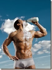 15368217-the-very-muscular-handsome-sexy-guy-on-sky-background-drink-milk-focus-on-face