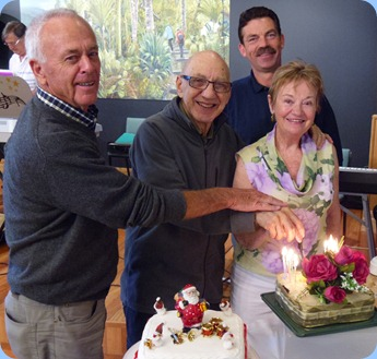 Also celebrating their Birthdays were Bob McNab (left);  Dennis Lyons; Peter Littlejohn; and Diane Lyons. Peter was commissioned to make the magnificent Birthday Cake for Dennis and Diane and we see them here at the cake cutting ceremony.