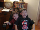Eidan and Kai sharing my desk chair