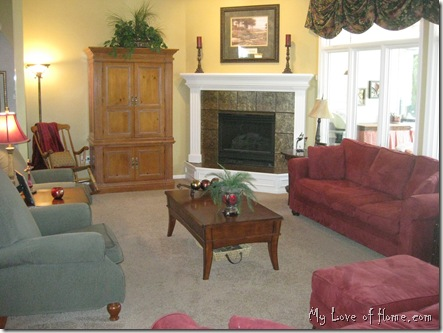 Red sofa couch, green chairs, white fireplace, pine TV cabinet, Living Room, gold walls