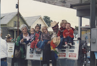 My sister, cousins, and dad's parents at my grandfather's service station. Taken a year or two before I was born.