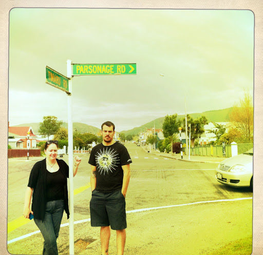 Mum was dying so I took my kids home. Here they are standing at the corner of the street I used to live on. The main street of my little village is behind them.  January 2011