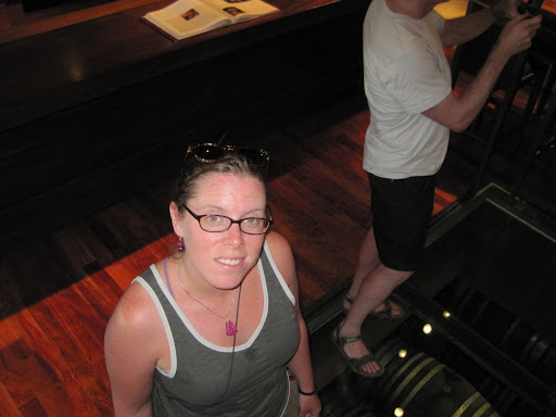 Heather standing on the glass floor in the Trapiche tasting room.