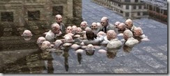 Politicians discussing global warming. A sculpture in Berlin by Issac Cordal.