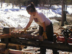 Our great friend Stephanie helps split some wood.
