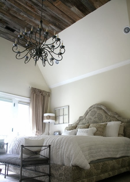 master bedroom with reclaimed wood ceiling & chandelier