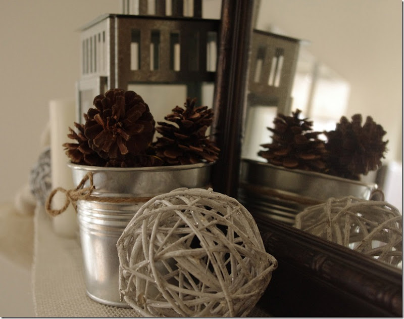 Christmas Mantel | IKEA decorative balls, SOCKER flowerpots, lantern, pinecones | personallyandrea.com