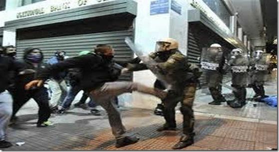 greekprotestorkickspoliceman