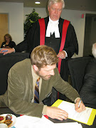 Ben signs his oath of office to assume his seat as CRD Director, December 2011