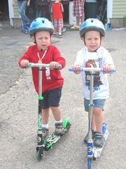 6.25.11 Kyle and Cody scooters