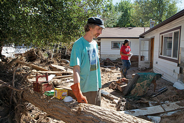 Musician David Tiller stands in the backyard of his destroyed recording studio and home that were in the path of the 2013 flooding in Lyons, Colorado. Photo: Melanie Stetson Freeman