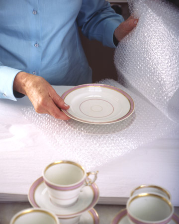 After the holidays, store your fine china with care to protect it. Inserting felt rounds, paper plates, or basket coffee filters between stacked dishes can help prevent scratching.