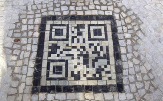 A QR codes made of the black and white stones covers a sidewalk near the beach in Rio de Janeiro, Brazil, Friday, Jan. 25, 2013. The QR codes are being placed at tourist spots which can be scanned with a mobile device for information about the site. (AP Photo/Silvia Izquierdo)