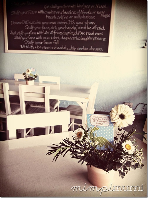 the outside seating area at stuff your face cafe. floral arrangement by Vanilla Floral Studio. signs designed by me.
