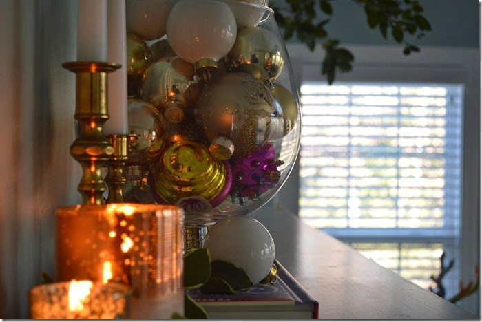 Ornaments in Apothecary Jars and Candles Make for a Cozy Mantel