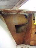 Anchor locker bulkhead - Rotten wood removed at top starbord corner. It may also be rotten at top port corner.