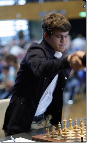 Magnus Carlsen, Norway shaking hands before start of play.