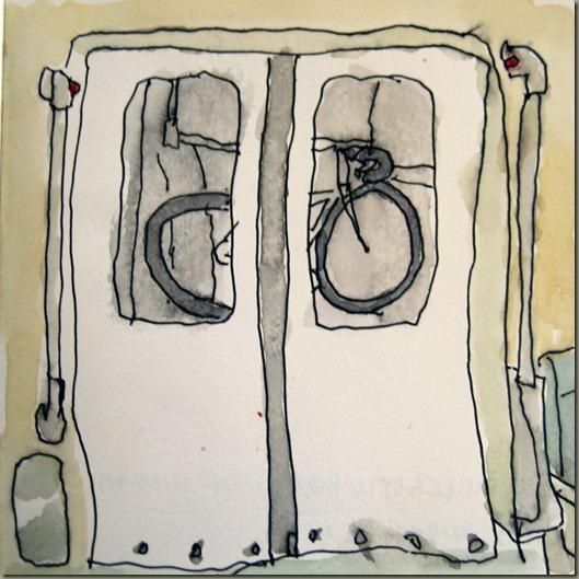Bike Reflected in BART Doors