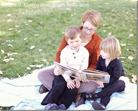 mother and children reading by Deirdre O. Keating
