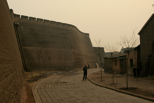 Lynette standing just inside the huge walls of Pingyao.