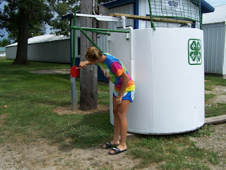 Mackenzie Adrian, 4-H County Council member, finalizes the paint job Thursday afternoon in preparation for Mondays Dunk Tank grand opening.  Photo Courtesy of the Washington County Extension.