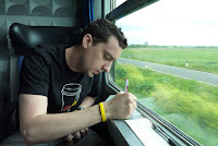 Writing postcards on the train