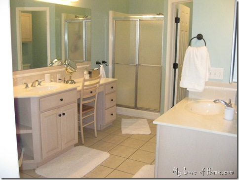 Spa bathroom, pale blue, white rugs,