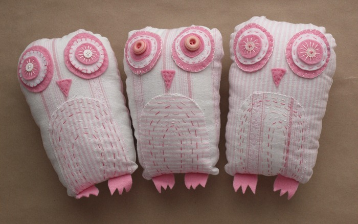 three pink owls