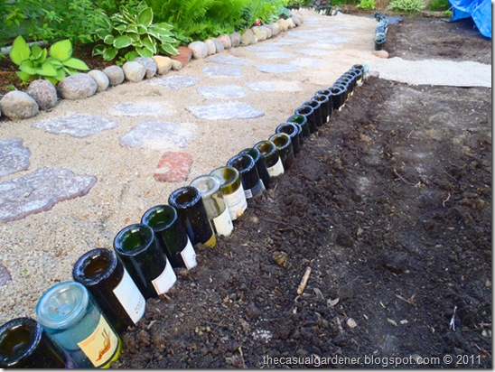 wine bottles stabilized by Organic Mechanics soil
