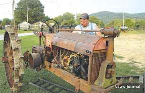 Man with old tractor 3x.jpg