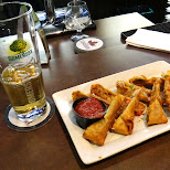 somersby beer and a pizza spring roll in Toronto, Ontario, Canada