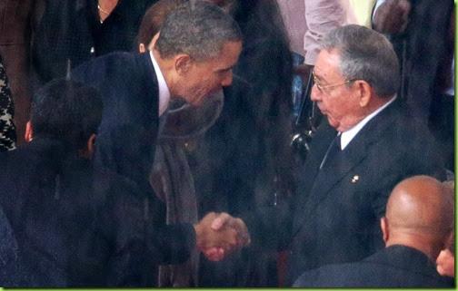 obama bows shakes hands castro