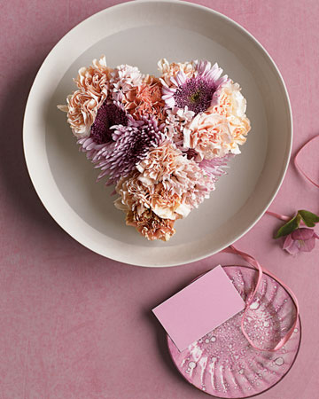 Try using carnations, mums, and hyacinths in soothing shades for this floating centerpiece.