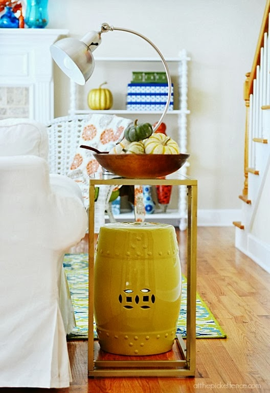 garden-stool-side-table-with-pumpkin-filled-dough-bowl