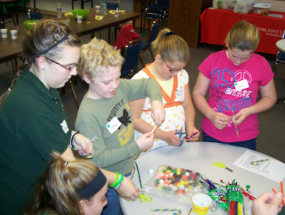Youth gathered for the 4-H WONDERland event designed Christmas cards and made candy cane reindeer to deliver to residents in the nursing homes.    County council member Lauren Carter demonstrated some creative touches to attendees Joey Gatchel, Samantha Mellinger and Shalyn Kirk.  Photo courtesy:  Washington County Extension.
