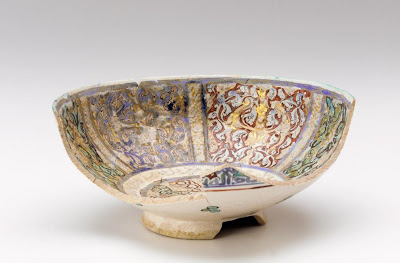 Bowl (fragmentary) | Origin:  Iran | Period: 1200-1300  Il-Khanid period | Details:  Not Available | Type: Stone-paste painted under and over glaze with lustre | Size: H: 9.0  W: 20.8  cm | Museum Code: S1987.85 | Photograph and description taken from Freer and the Sackler (Smithsonian) Museums.
