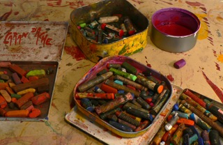 Oil pastels are a heavily used medium in Booth's paintings.