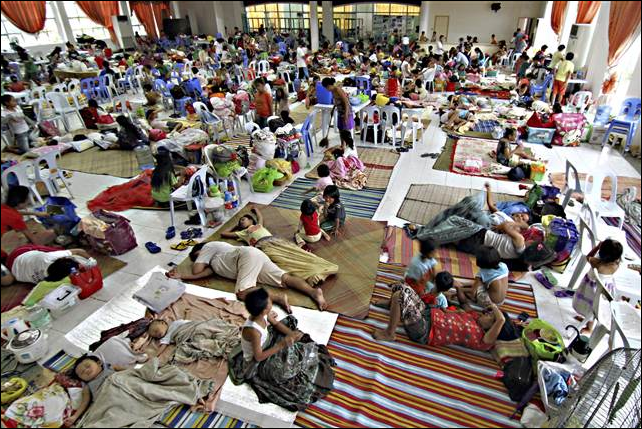 Hundreds of residents take shelter inside the provincial capital of Surigao in the Philippines on 5 December 2014, as Super Typhoon Hagupit approaches. Photo: Erwin Mascarinas / AP