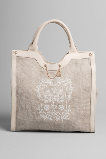 Mixing leather and linen is a chic idea for a tote. The bag is perfect summer carryall.