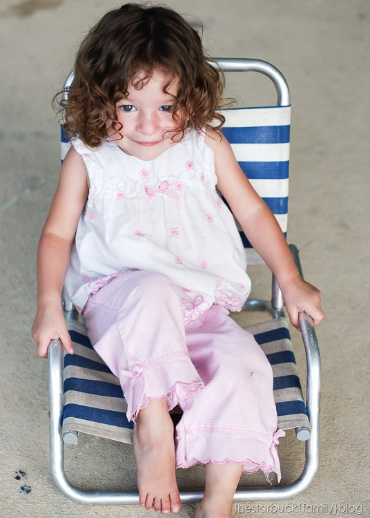 Abby playing with lawn chair and in carport blog-17